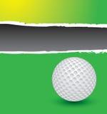 Golf ball on green ripped advertisement Stock Photo