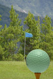 Golf ball with green scenery Royalty Free Stock Images