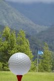 Golf ball with green scenery Royalty Free Stock Photo