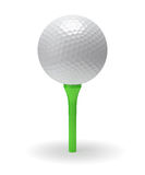 Golf ball on green tee Royalty Free Stock Images