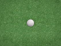 Golf ball on green top view Royalty Free Stock Photography