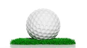 Golf ball on green turf patch Stock Photo