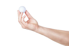 Golf ball in hand. Royalty Free Stock Image