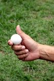 Golf ball in hand Royalty Free Stock Photos