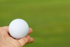 Golf ball in hand Stock Photo