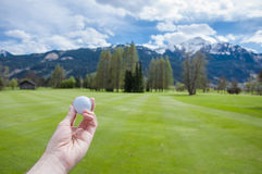 Golf ball on hand Stock Images