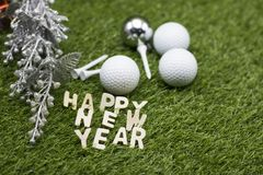Golf ball with Happy birthday sign on green grass Royalty Free Stock Images