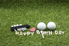 Golf ball with Happy birthday sign on green grass Royalty Free Stock Photos