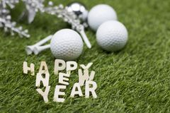 Golf ball with Happy new year sign on green grass Royalty Free Stock Photos
