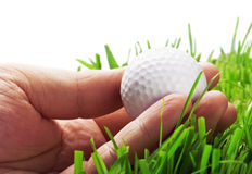 Golf ball in his hand Stock Image