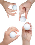 Golf ball. Hold by a woman hand Royalty Free Stock Photo