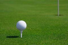 Golf ball and hole royalty free stock photography