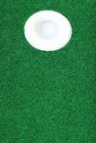 Golf ball in the hole Stock Image
