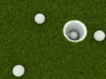 Golf ball in the hole Stock Photography
