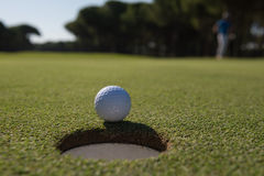 Golf ball in the hole Stock Photos
