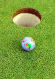 Golf ball in the hole, golf in the world Stock Photos