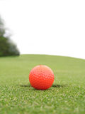 Golfing on the green. Golf ball beside hole on the green royalty free stock image