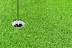 Golf ball hole on green. Royalty Free Stock Photos