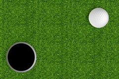 Golf ball and hole on the green grass of the golf Stock Photo