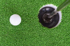 Golf ball and hole. On green grass, sport concept Royalty Free Stock Images