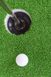 Golf ball and hole. On green grass, sport concept Royalty Free Stock Photos