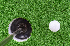 Golf ball and hole. On green grass, sport concept Stock Photography