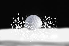 Golf ball and hole Royalty Free Stock Images