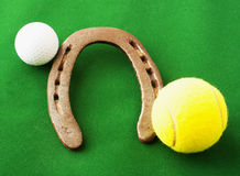 Golf ball, horseshoe, tennis ball Royalty Free Stock Image