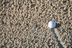 Golf Ball In The Sand Royalty Free Stock Image