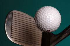 Golf ball and iron. Close-up of sand iron and golf ball Royalty Free Stock Photos