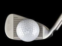 Golf ball and iron club closeup Royalty Free Stock Image