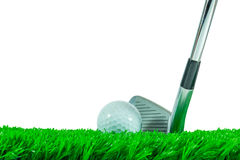 Golf ball and iron club. White golf ball and iron club on green artificial grass Royalty Free Stock Photography