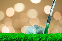 Golf ball and iron club Stock Photography