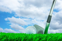 Golf ball and iron club Stock Photo