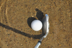 Golf Ball and Iron in a Water Hazard Stock Photos