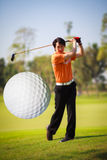 A golf ball just coming off the tee Stock Images