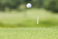 Golf ball just coming off the tee Royalty Free Stock Photo