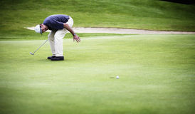 Golf ball just missed hole. Stock Images