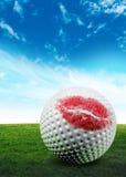 Golf ball kiss. A red lipstick golf ball kiss Stock Photo
