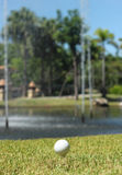 Golf Ball and lake Royalty Free Stock Image