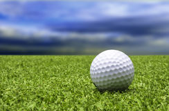 Golf ball on lawn Stock Photo