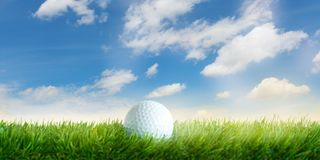 Golf ball lies in the grass before blue sky with white clouds stock illustration