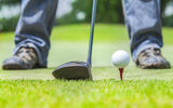 Golf ball. On lip of cup Stock Images