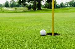 Golf ball on lipon the green Stock Photo