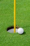 Golf ball on lipon the green royalty free stock photos