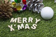 Golf ball Merry X`mas sign on green grass Stock Photos