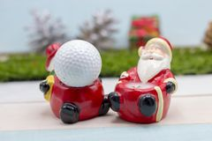 Golf ball Merry X`mas sign on green grass Royalty Free Stock Photography