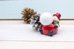 Golf ball Merry X`mas sign on green grass Stock Images