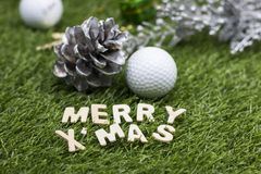 Golf ball Merry X`mas sign on green grass Royalty Free Stock Image