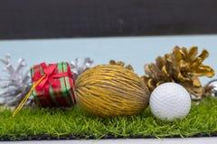 Golf ball Merry X`mas sign on green grass Stock Photography